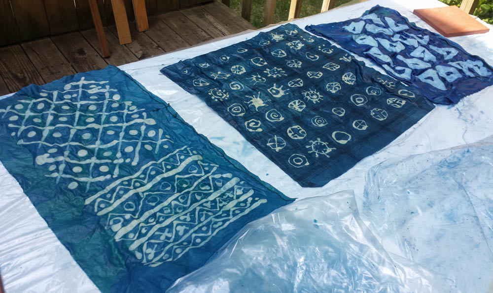 experiment with wax resist batik and indigo dye