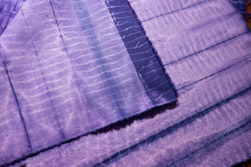 nui yoro shibori -- narrow pleats, stitched together and pressed with starch, then wrapped around a thick cord and tied