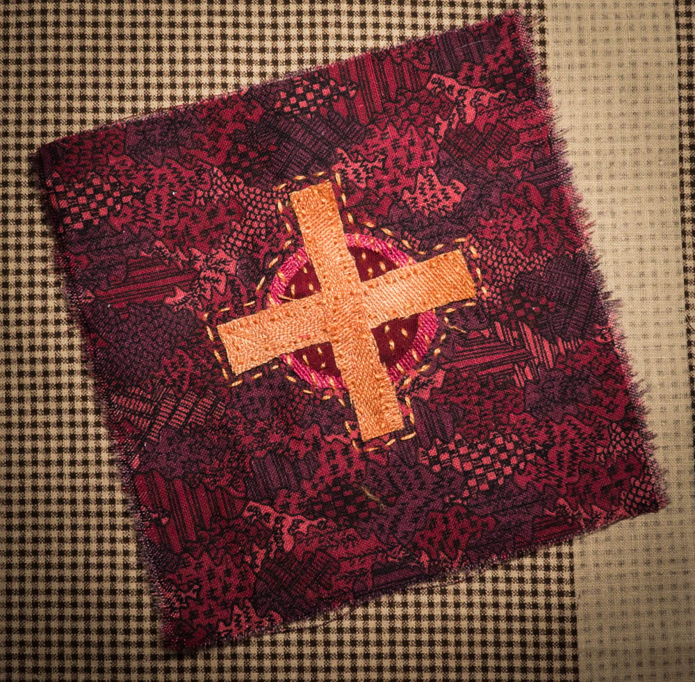 cross, appliqued